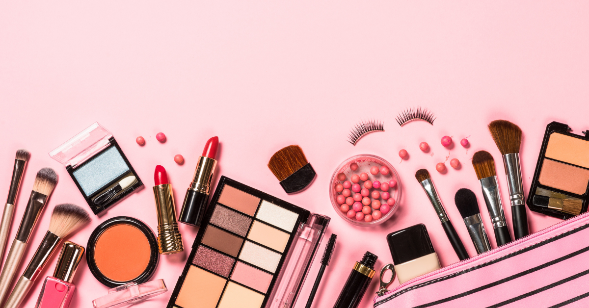 Various make-up products on a pink fond used for a marketing campaign