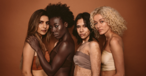 women of different skin colors posing