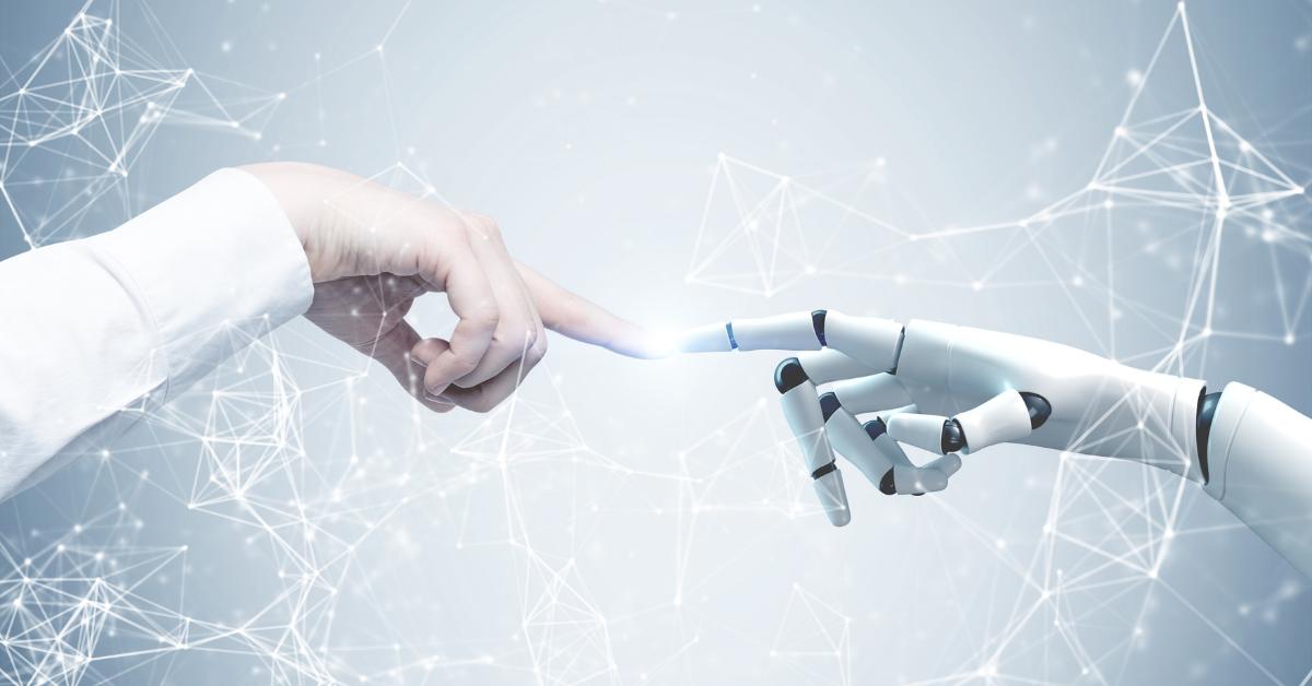 Un robot care atinge un om