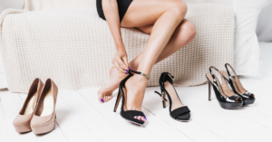 A woman trying on elegant shoes