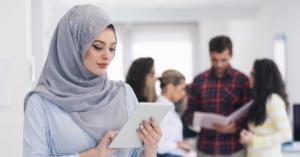 Muslim woman using a tablet