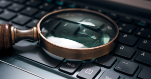 magnifying glass placed on a keyboard